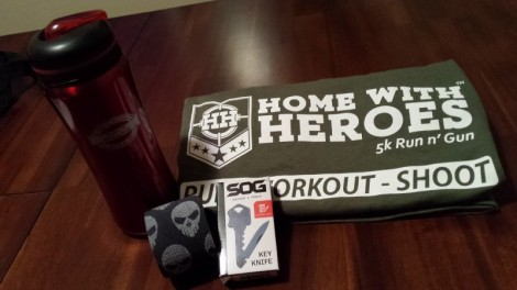 Some SWAG from the race and sponsors. Officail Race T-shirt, metal water bottle from the English Pit, rockin' skull elastic support tape, and a SOG key-knife.
